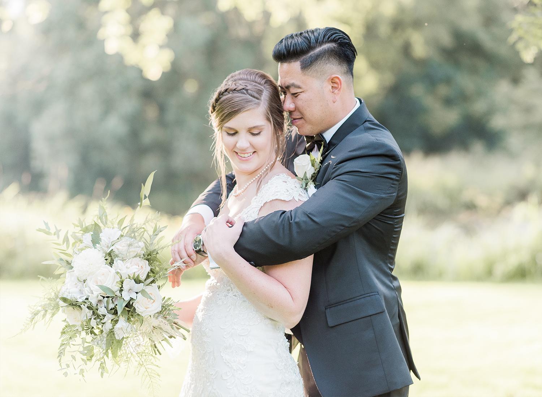 bride and groom posing in beautiful golden light